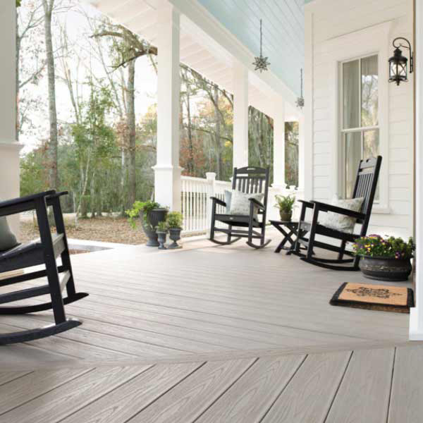 Trex decking on porch with rocking chairs and light-blue painted porch ceiling