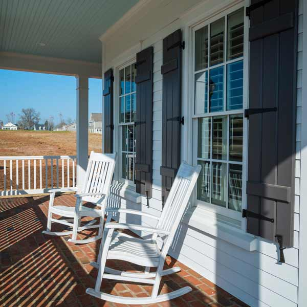 southern living this old house all american cottage front porch with painted light blue ceiling and rocking chairs