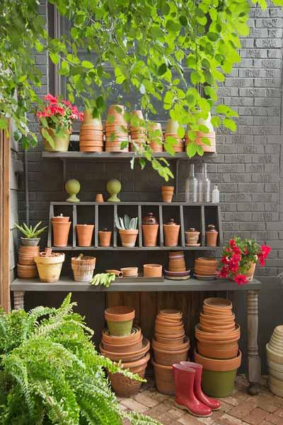 secret garden on urban plot potting bench with potting plants display