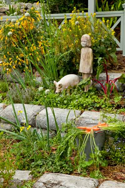 garden planning romantic garden vegetable garden with statue of little girl and piglet