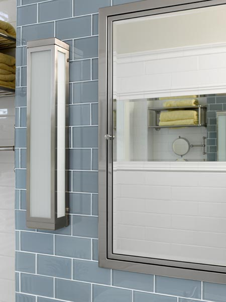 a streamlined satin-nickel medicine cabinet and sconces, along with the glass tile help brighten this sleeker bath after remodel