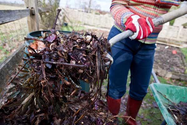 person turning over compost leaves, fast fixes for august
