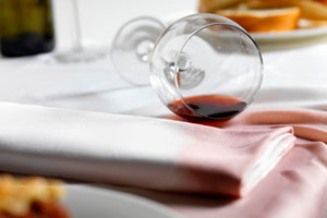 red wine spill on table cloth