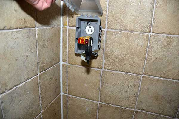 a shower built around an existing electrical receptacle as part of This Old House's Home Inspection Nightmares 30