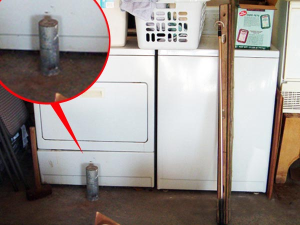 support post cut off to make room for a dryer unit as part of This Old House's Home Inspection Nightmares 30