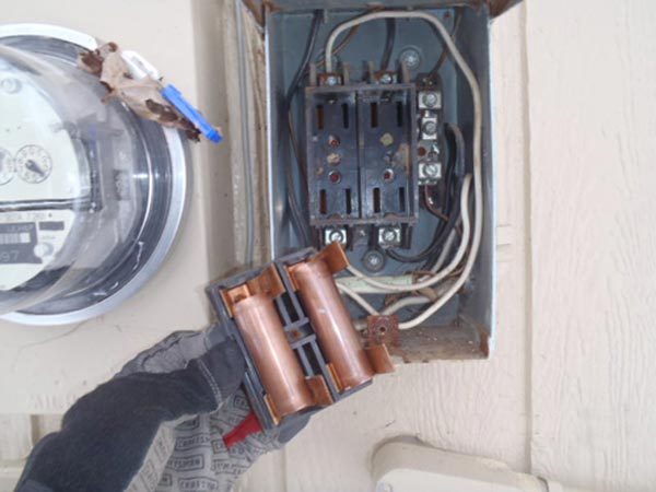 copper piping used to replace those fuses outside next to the meter base as part of This Old House's Home Inspection Nightmares 30