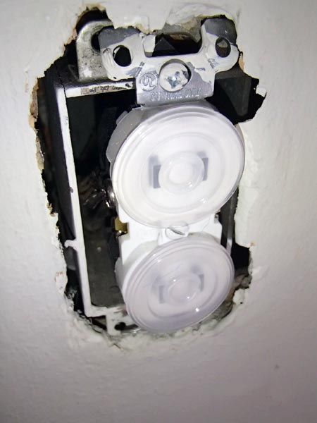 exposed box wires and receptacle above a child's crib as part of This Old House's Home Inspection Nightmares 30