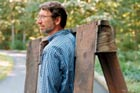 TOH TV master carpenter norm abram carrying a sawhorse