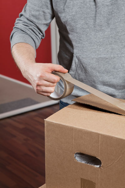man using packing tape to close cardboard box, 10 uses for toothpicks