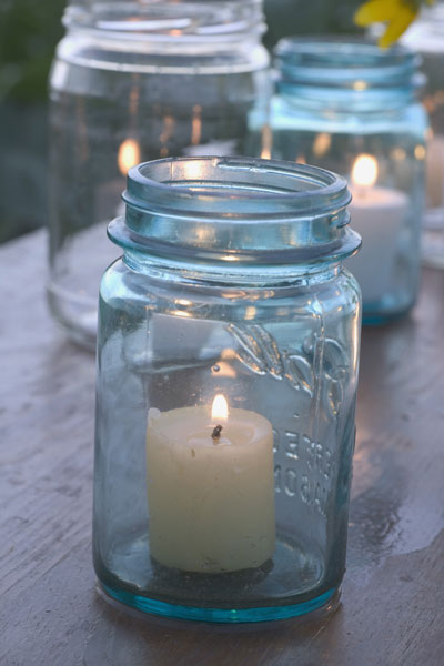 lit candle in mason jar, 10 uses for toothpicks