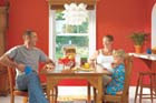 homeowner hoekstra and family in dining room, lake cottage before and after