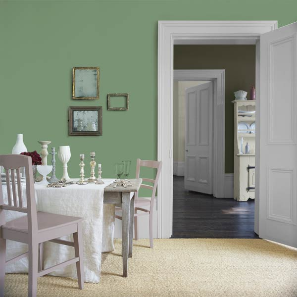 dining room with eclectic vintage decor and glidden sea glass green painted walls, hemlock green from pantone color of month may 2014