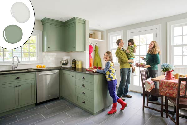 kitchen with green painted cabinets and light walls, ask this old house tv producer chris wolfe with family in remodeled kitchen