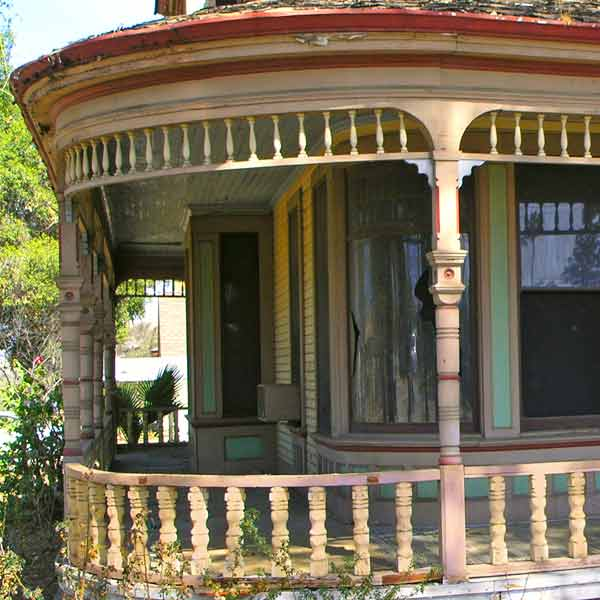 wrapped front porch with turned posts, save this old house queen anne riverside california