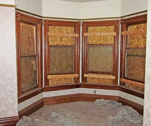 interior view of window bay with fluted casings, save this old house queen anne riverside california
