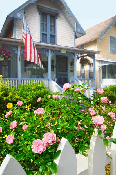 front yard with white picket fence and roses, state flowers