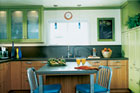 kitchen with revamped green cabinets