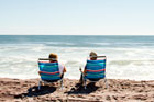 couple sits on beach chairs at the beach