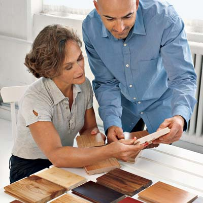 couple looks at wood flooring samples