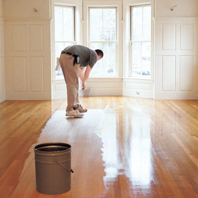 person finishing a site-finished floor