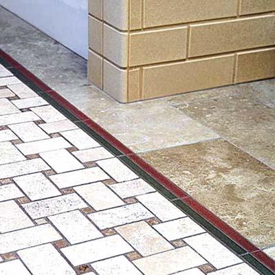 basket-weave stone tile in a bathroom remodel