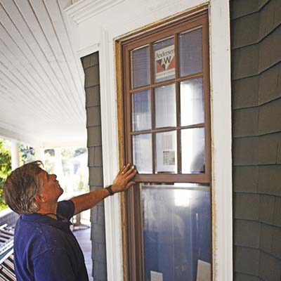 Tom Silva checks out a double-hung window