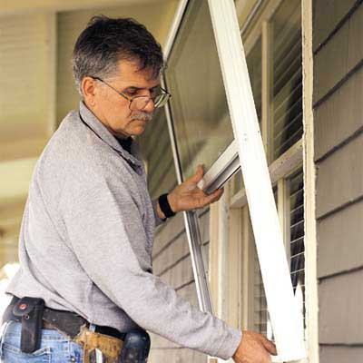 Tom Silva installs a storm window