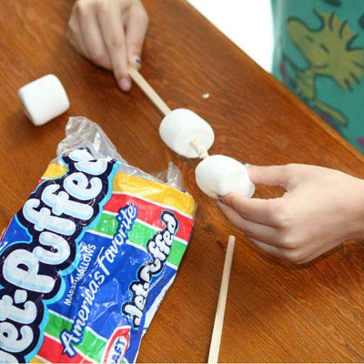 Chopsticks used to skewer marsh-mallows