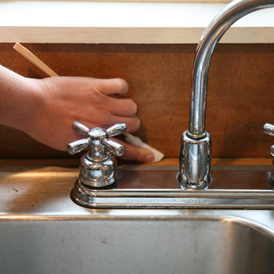 Chopsticks used to clean a sink faucet