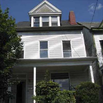 with a high dormer with pediment and a large front porch, this pittsburgh house great potential