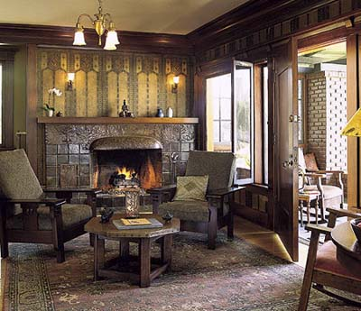 Living room with restored wall paper and fireplace