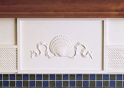 sandblasted fireplace surround tile in new Shingle-style house