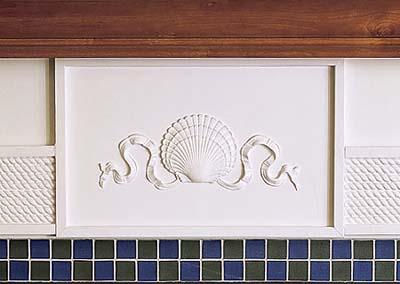sandblasted fireplace surround tile in new Shingle-style house