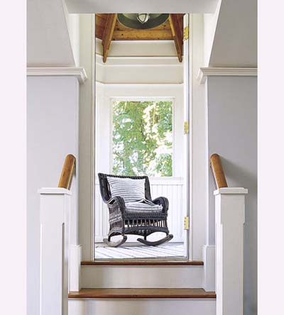 screened-in porch in octagonal tower of new Shingle-style house