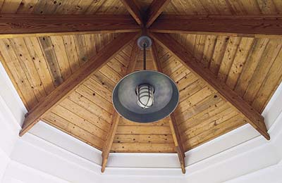 light fixture in octagonal tower of new Shingle-style house