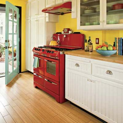 a kitchen filled with bright yellows, reds and greens