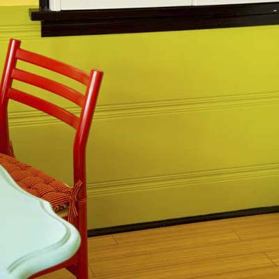 close up of green-painted wainscoting in a kitchen dining area