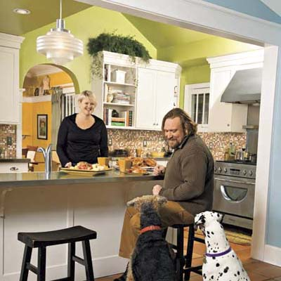 couple and their dogs in their newly remodeled kitchen