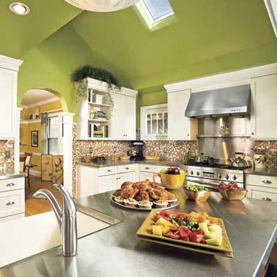 vaulted green ceilings and pantry window in a kitchen