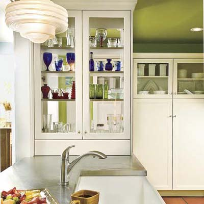 a cabinet with see-through doors in a newly remodeled kitchen