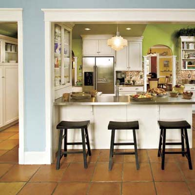 Earth toned flooring a kitchen opens up for better flow for Terracotta kitchen ideas