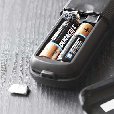 fold a piece of aluminum foil to place between a battery and loose spring