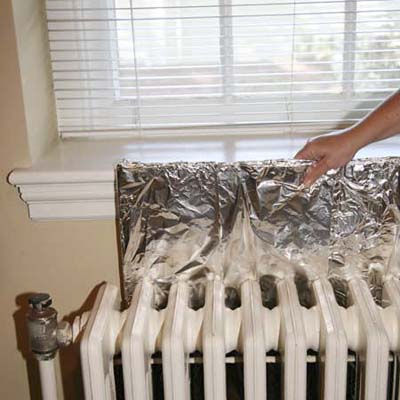 use aluminum foil over plywood to reflect radiator heat into the room