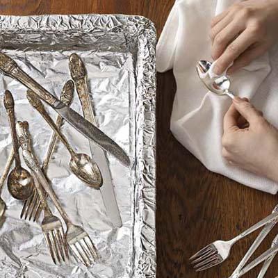 soak your silver in an aluminum foil-lined pan with baking soda and water to make your shine
