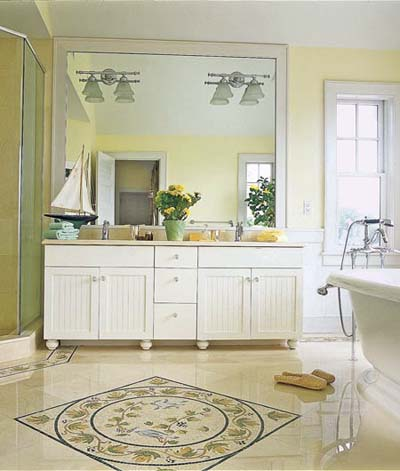 Mosaic floor, ceiling-height mirror and vanity in Montauk bathroom