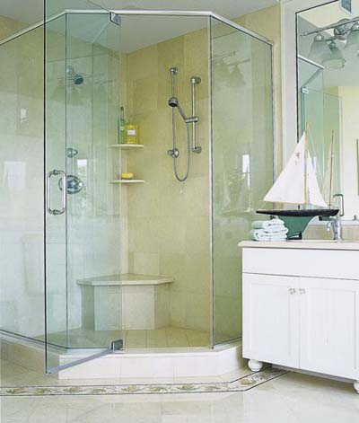 shower with glass doors and multiple showerheads