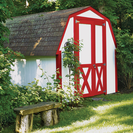 white garden shed with red trim