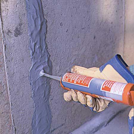 injecting epoxy into the crack