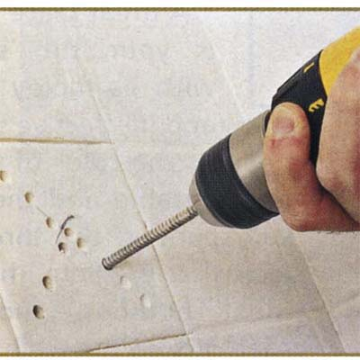 Choosing the right location and drilling holes into the tile for removal