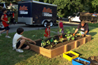 Roger Cook and kids around the completed raised vegetable garden